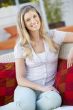 Portrait Of Woman Relaxing On Outdoor Seat Stock Photos