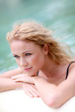 Portrait of woman relaxing in pool Royalty Free Stock Photos