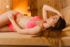Portrait of woman relaxing in sauna. Spa wellbeing Stock Image