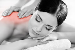 Portrait of a woman relaxing on a spa massage. Healthy beautiful woman in a spa. Recreation energy health massage healing concept royalty free stock photos