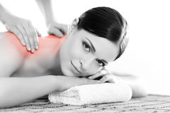 Portrait of a woman relaxing on a spa massage. Healthy beautiful woman in a spa. Recreation energy health massage healing concept stock images