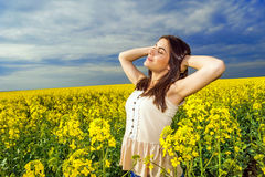 Portrait of woman relaxing in yellow colored field Royalty Free Stock Photography