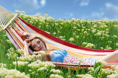 Portrait of woman resting in a hammock Stock Photos