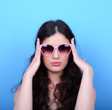 Portrait of woman with retro glasses against blue background Royalty Free Stock Photography