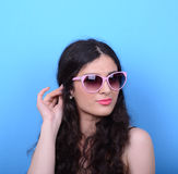 Portrait of woman with retro glasses against blue background Royalty Free Stock Images
