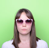 Portrait of woman with retro glasses against green background Royalty Free Stock Photos