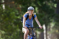 Portrait of woman riding bicycle Royalty Free Stock Photos