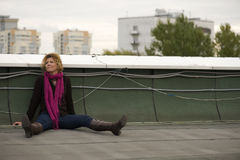 Portrait woman on roof in city Stock Images