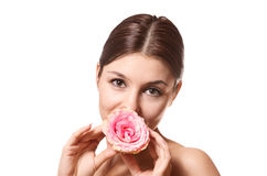 Portrait of woman with a rosebud in the mouth Stock Photography