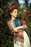 Portrait of a woman with rowan. In the hair near the tree Royalty Free Stock Image
