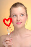 Portrait of woman with Saint Valentine's heart Royalty Free Stock Photography