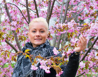 Portrait of a woman with sakura stock images