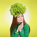 Portrait of a woman with the salad on her head Royalty Free Stock Images