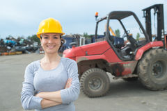 Portrait woman in salvage yard Royalty Free Stock Photo