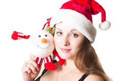 Portrait of woman in santa cap with snowman. On white background. The concept of holiday and christmas stock photo