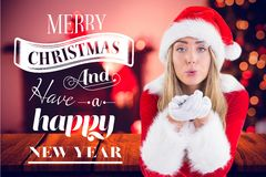 Portrait of woman in santa costume blowing a kiss Royalty Free Stock Image