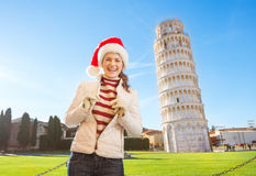 Portrait of woman in Santa hat in front of Leaning Tour of Pisa Stock Photo