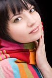 Portrait of the woman with scarf. On black background Stock Image