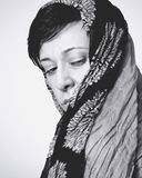 Portrait of a woman with a scarf. Black and white portrait of a woman with a scarf,noise added Royalty Free Stock Images