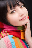 Portrait of the woman with scarf. On black background Royalty Free Stock Photos