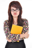 Portrait of woman scowling and hugged blank books, isolated on w Royalty Free Stock Photo