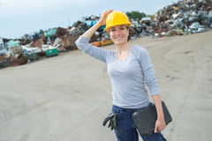 Portrait woman in scrapyard Stock Photo