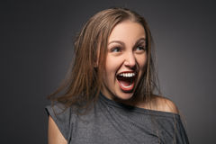 Portrait of woman screaming amazed in shock Stock Image
