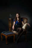 Portrait of woman seated in a chair Royalty Free Stock Photography