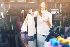 Portrait of woman selling wallets and purses Royalty Free Stock Images