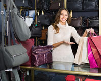Portrait of woman selling wallets and purses Stock Photo