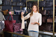 Portrait of woman selling wallets and purses Stock Images