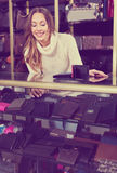 Portrait of woman selling wallets and purses Royalty Free Stock Image