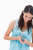 Portrait of a woman sending a text message Royalty Free Stock Photo