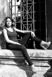Portrait of woman serious sitting outdoors black and white Stock Photography