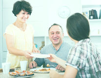 Portrait of woman serving dishes for lunch. Portrait of women serving dishes for family lunch at home Royalty Free Stock Photo