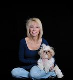 Portrait of a Woman and a Shih Tzu dog. Portrait of a woman and her Shih Tzu dog on a black background royalty free stock photo