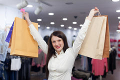 Portrait of woman with shopping bags. At fashionable store Stock Image