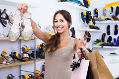 Portrait of  woman with shopping bags having picked shoes in han Royalty Free Stock Photo