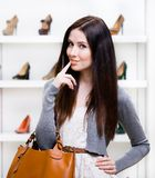 Portrait of woman in shopping center. In the section of female high heeled shoes. Concept of consumerism and stylish purchase Stock Photography