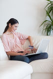 Portrait of a woman shopping online Royalty Free Stock Images