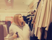 Portrait of a woman shopping in retail store. Sale concept stock image