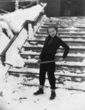 Portrait of woman shoveling snow Royalty Free Stock Photos