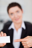 Portrait of a woman showing a blank business card Royalty Free Stock Image
