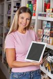 Portrait Of Woman Showing Digital Tablet At Royalty Free Stock Photography