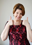 Portrait of woman showing gesture that everything is fine Royalty Free Stock Images