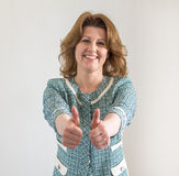 Portrait of  woman showing gesture that everything is fine Royalty Free Stock Photo