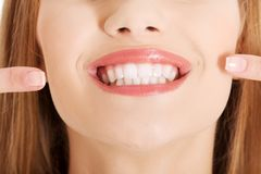 Portrait of woman showing her teeth Royalty Free Stock Images