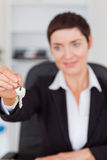 Portrait of a woman showing keys Royalty Free Stock Photography