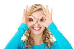Portrait of a woman showing ok sign on eyes Royalty Free Stock Photography
