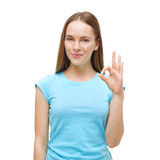 Portrait of a woman showing ok sign and smiling isolated Royalty Free Stock Images